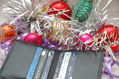 Wallet and xmas decorations. Does Christmas mean more credit card debts Royalty Free Stock Photo