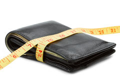 Wallet with yellow tape measure stock image