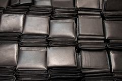 Wallets. A large number of black leather wallets stock photo