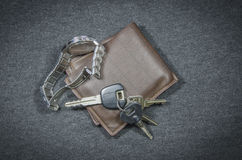 Wallets and car key of wristwatch Royalty Free Stock Image