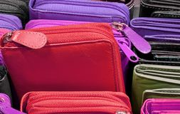 Wallets of colored leather for sale in the store stock image