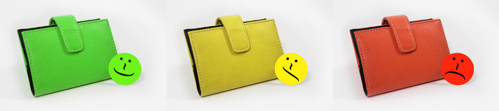 Wallets with emoticons showed in three steps from good to bad Royalty Free Stock Photo