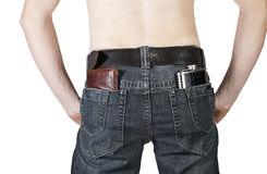 Wallets and a flask in his back pocket men's jeans Stock Photography