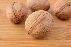 Wallnuts over wood Royalty Free Stock Image