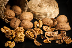 Wallnuts on a table in small baskets Stock Image