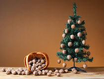 Wallnuts in a wicker basket with a pine tree Stock Photo
