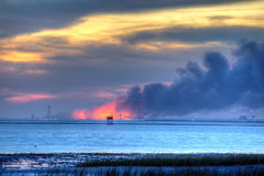 WALLOPS ISLAND, VA - OCT 28, 2014: An Antares rocket burns on the launch pad at NASA's Wallops Flight Facility. An Orbital Sciences Corp. rocket exploded Royalty Free Stock Photo
