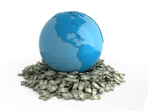 Wallow in money. Isolated blue globe on heap of money Royalty Free Stock Photo