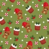 圣诞节玩具熊、礼物盒和糖果绿色无缝的wallpape 库存图片