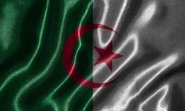 Wallpaper by Algeria flag and waving flag by fabric. Algeria flag - Fabric flag of Algeria country, Background and wallpaper of waving flag by textile Stock Photography