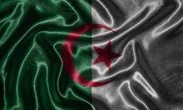 Wallpaper by Algeria flag and waving flag by fabric. Algeria flag - Fabric flag of Algeria country, Background and wallpaper of waving flag by textile stock photos