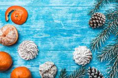Wallpaper of azure wood, open, sea. Mandarins. Green fir tree. Decorative cones. Holidays for holidays. Space for Xmas and New Year Message. Sweets for Stock Photos