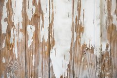 Chipped paint on wooden planks background or texture. Wallpaper background of chipped white paint over weathered wooden planks Royalty Free Stock Images