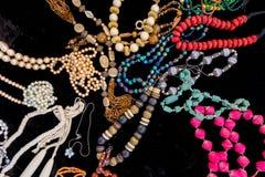 Old colorful jewelery on black velvet. Royalty Free Stock Photo