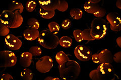 Wallpaper or background with the image of Jack's lanterns in the form of pumpkins. Stock Photography