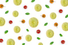 Raw material with lemon slice, basil leaves, tomato on white background. Wallpaper and background of raw material with lemon or lime, basil leaves and tomato stock photography