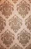 Wallpaper. Beautiful wallpaper beige with monograms Stock Photography
