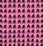 Wallpaper black skulls on pink background Royalty Free Stock Photos