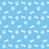Wallpaper of bones and paws. Vector illustration. Blue baground and white pattern Royalty Free Stock Photo