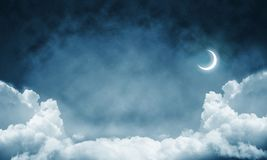 Wallpaper of cloud night skyscape. Panoramic view of dark cloudy skyscape at night with new month. Wallpaper or backdrop with copyspace Stock Photos