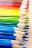 Wallpaper for creative people. Different colored pencils for art. Back to school. Many multicolored pencils on a wooden background. Different colored pencils Royalty Free Stock Photography