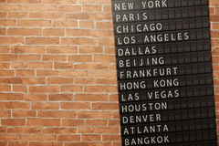 Wallpaper decorated with terminal flip board showing destination cities Stock Images