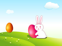 Wallpaper of Easter egg and baby rabbit. Illustration of Easter wallpaper with Easter eggs and cute baby rabbits in the meadow Stock Photo