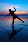 Silhouette. Girl sunset bluewater royalty free stock image