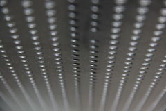 Wallpaper. Metal table with perforated interesting Stock Image