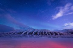Wallpaper norway landscape nature of the mountains of Spitsbergen Longyearbyen Svalbard building snow city on a polar daynight wit stock photography