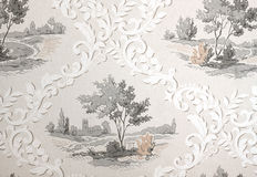 Wallpaper with old retro design. A vintage old wallpaper from the fifties, with stenciled trees and ornaments Royalty Free Stock Photos