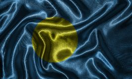 Wallpaper by Palau flag and waving flag by fabric. stock photo
