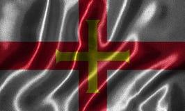 Wallpaper par le drapeau de Guernesey et le drapeau de ondulation par le tissu illustration de vecteur