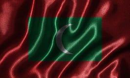 Wallpaper par le drapeau des Maldives et le drapeau de ondulation par le tissu image stock