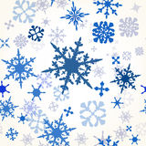 Wallpaper pattern with hand drawn shiny snowflakes ideal for Chr. Christmas vector seamless wallpaper pattern with blue snowflakes Royalty Free Stock Image