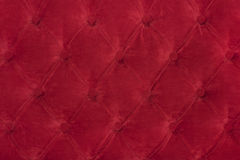 Wallpaper of red color in style Chesterfield. Red wallpaper in style Chesterfield with buttons Royalty Free Stock Photo