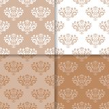Wallpaper set of brown beige seamless patterns with floral ornaments. Set of floral ornaments. Brown beige seamless patterns for wallpapers and fabric. Vector Stock Image