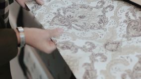 Wallpaper shop. Closeup of woman hands comparing two samples of wallpaper for her home decor, house repair, interior. Design stock footage