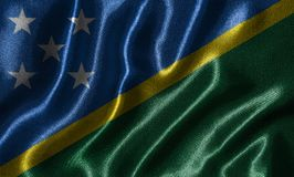Wallpaper by Solomon Islands flag and waving flag by fabric. royalty free stock photo