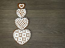 Wallpaper for tablet gadget with a heart shaped cookies with icing on a wooden background