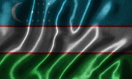 Wallpaper by Uzbekistan flag and waving flag by fabric. Uzbekistan flag - Fabric flag of Uzbekistan country, Background and wallpaper of waving flag by textile royalty free stock images