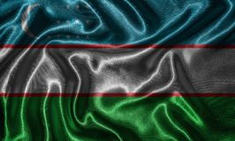 Wallpaper by Uzbekistan flag and waving flag by fabric. Uzbekistan flag - Fabric flag of Uzbekistan country, Background and wallpaper of waving flag by textile royalty free stock photo