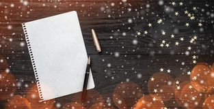 Wallpaper of winter holidays on black background. Letter for Santa Claus. Space for text. Top view. Effect of light blips and snow. Flakes stock photo