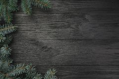 Wallpaper of winter holidays on black background. Side fir branches. Space for text. Top view royalty free stock images