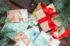 Wallpaper for winter holidays, Gift for loved ones. Money of different values. Top view royalty free stock photography