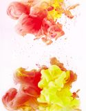 Wallpaper with yellow and red paint swirls, isolated on white stock photos