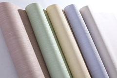 Wallpapers, close up. light-colored. The light-colored Wallpaper in rolls are on the table stock photography