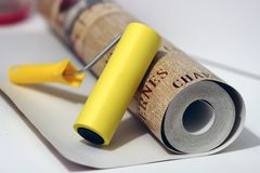 Wallpapers and roller. Roll of wallpaper and roller ready to work stock photo