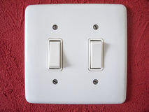 Wallplate on red wall. White Wallplate switch on red wall Royalty Free Stock Images