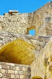 Walls of ancient acropolis at Lindos Stock Photos